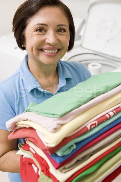 Woman Holding Folded Laundry Stock photo © monkey_business