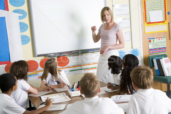 Stock photo: A teacher teaching a junior school class