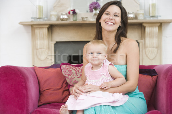 Mother in living room with baby smiling Stock photo © monkey_business