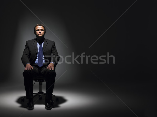 Businessman Sitting In Spotlight Stock photo © monkey_business