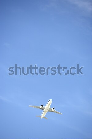 Commercial Airplane Flying Against A Blue Sky Stock photo © monkey_business