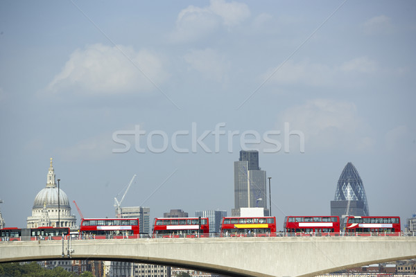 Double Decker Buses Lined Up On A Bridge With St Paul's Cathedra Stock photo © monkey_business