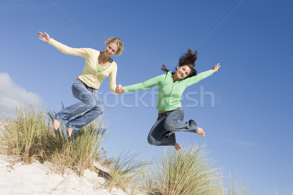 Two young women having fun at beach Stock photo © monkey_business