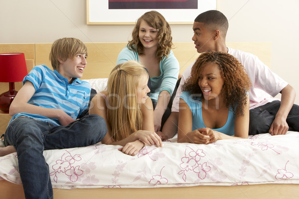 Group Of Five Teenage Friends Hanging Out In Bedroom Stock photo © monkey_business