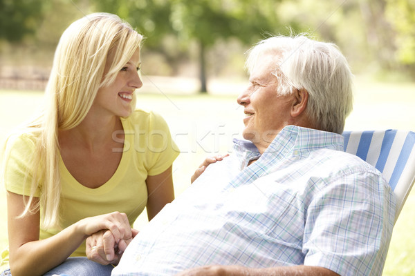 Stock photo: Senior Man Talking To Adult Daughter