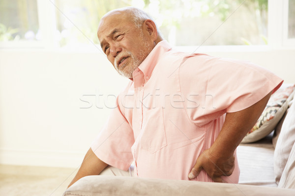 Stock photo: Senior Man Suffering From Back Pain At Home