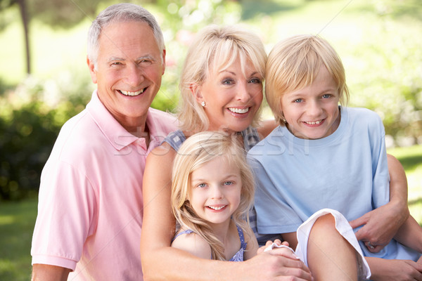 Senior couple with children posing in park Stock photo © monkey_business
