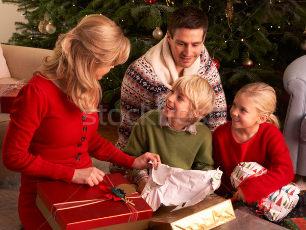 Family Opening Christmas Gifts At Home Stock photo © monkey_business