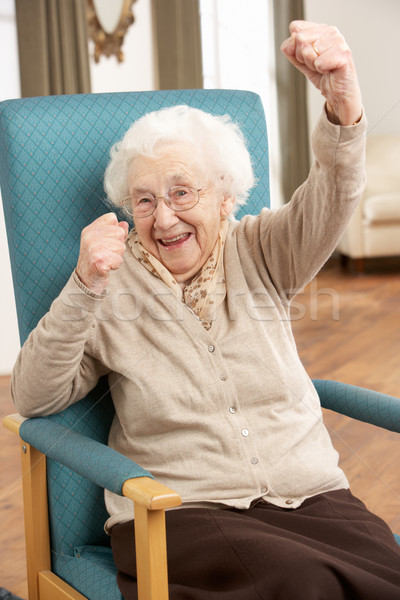 Senior Woman Celebrating In Chair At Home Stock photo © monkey_business