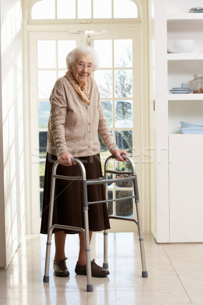 Stock photo: Elderly Senior Woman Using Walking Frame