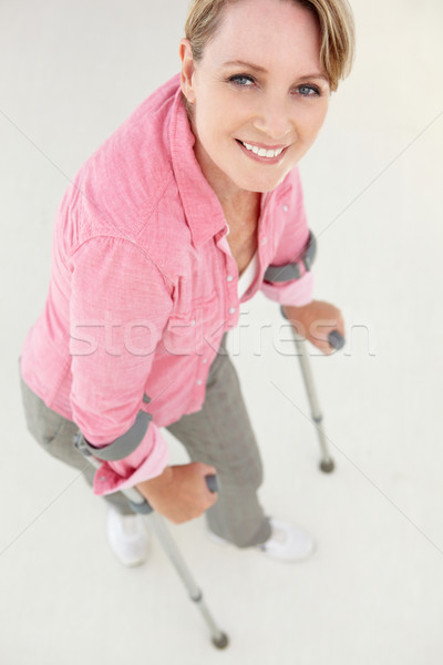 Woman walking with crutches Stock photo © monkey_business