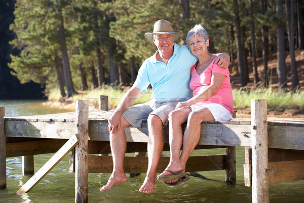 Stock photo: Senior couple sitting by lake