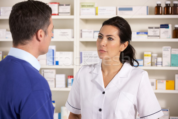 American pharmacist talking to man in pharmacy Stock photo © monkey_business