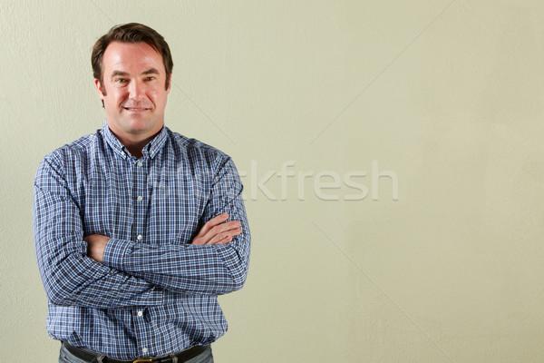 Stúdiófelvétel nyugodt középkorú férfi férfi mosolyog kaukázusi Stock fotó © monkey_business