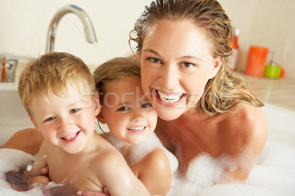 Mother With Children Relaxing In Bubble Filled Bath Stock photo © monkey_business