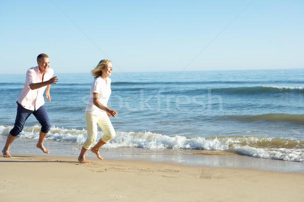 Casal de idosos romântico férias na praia homem mulheres Foto stock © monkey_business