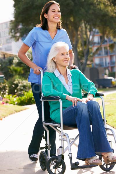 Carer Pushing Senior Woman In Wheelchair Stock photo © monkey_business