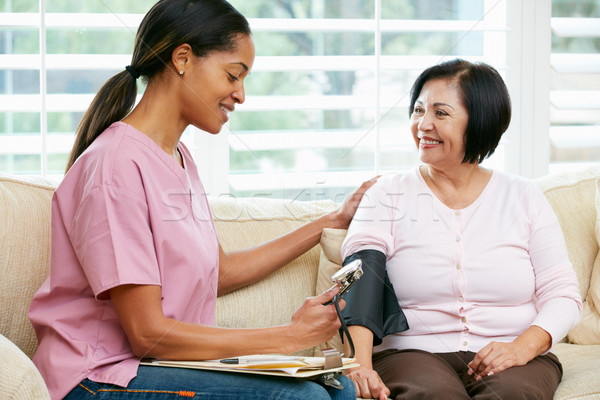 Nurse Visiting Senior Female Patient At Home Stock photo © monkey_business