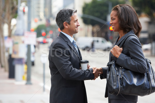Businessman And Businesswoman Shaking Hands In Street Stock photo © monkey_business