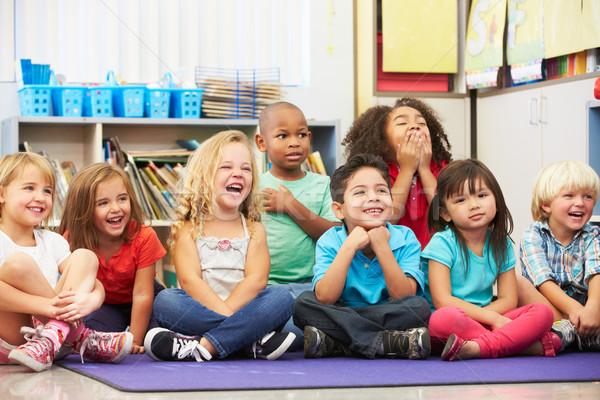 Grupo elementar alunos sala de aula escolas criança Foto stock © monkey_business