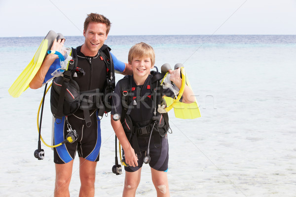 Father And Son With Scuba Diving Equipment On Beach Holiday Stock photo © monkey_business