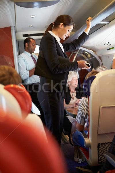 Stock fotó: üzletasszony · mobiltelefon · elfoglalt · ingázó · vonat · nő