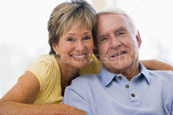Stock photo: Couple relaxing in living room smiling