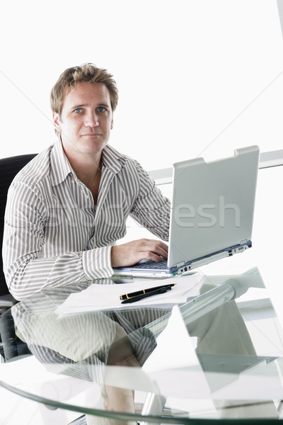 Businessman in boardroom with laptop Stock photo © monkey_business