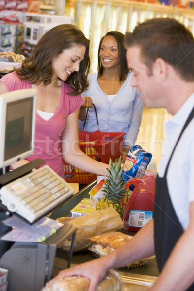 Stock photo: Woman paying for groceries
