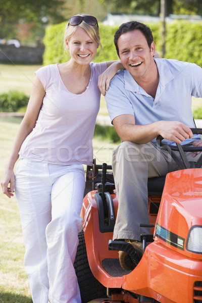 Couple outdoors with lawnmower smiling Stock photo © monkey_business