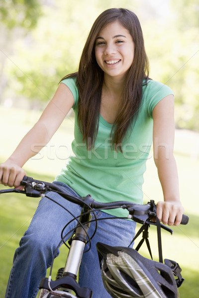 Bicicleta menina exercer sorridente ciclismo Foto stock © monkey_business