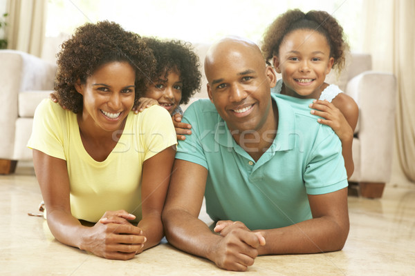 Family Relaxing At Home Together Stock photo © monkey_business