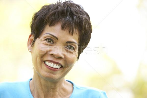 Stock photo: Portrait Of Smiling Senior Woman Outdoors