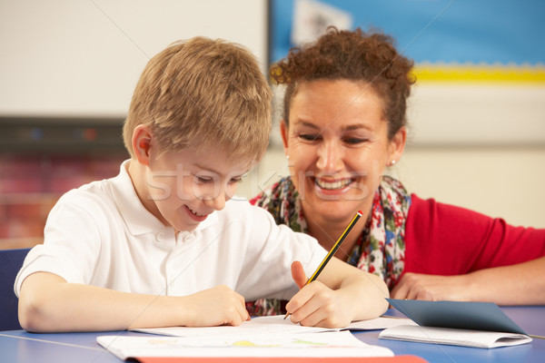 Schoolboy Studying In Classroom With Teacher Stock photo © monkey_business