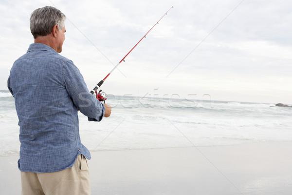 Photo stock: Supérieurs · homme · pêche · mer · plage · poissons