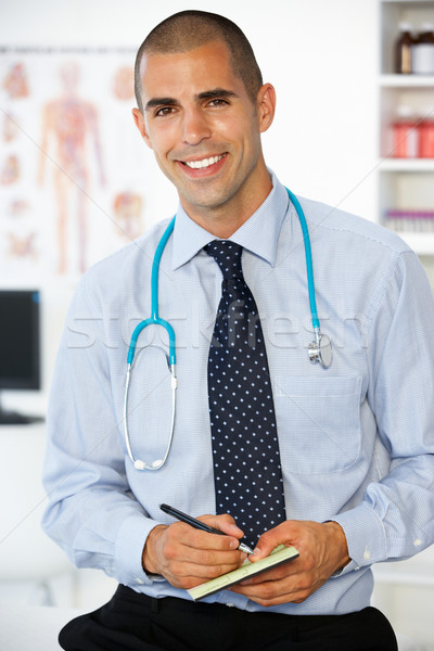 Young male doctor writing prescription Stock photo © monkey_business