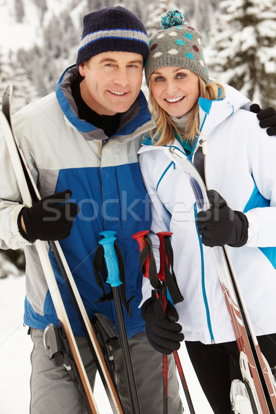 Middle Aged Couple On Ski Holiday In Mountains Stock photo © monkey_business