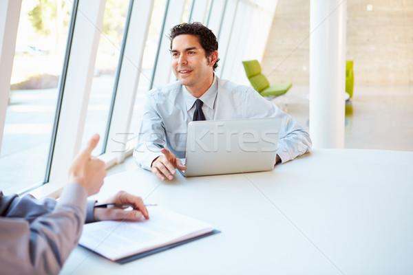 Deux affaires réunion autour table modernes Photo stock © monkey_business