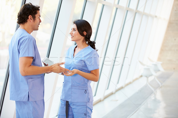 Medical Staff Talking In Hospital Corridor With Digital Tablet Stock photo © monkey_business