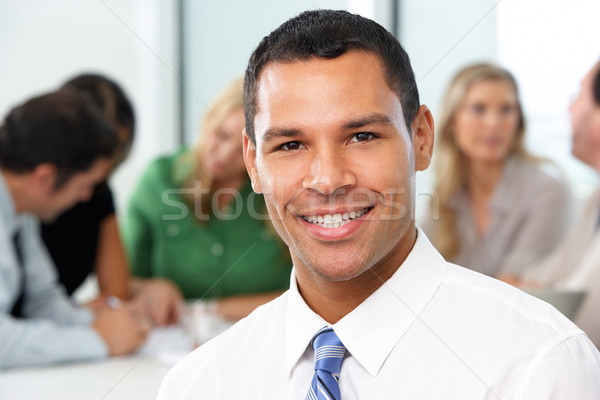 Portrait Of Businessman Sitting At Boardroom Table Stock photo © monkey_business