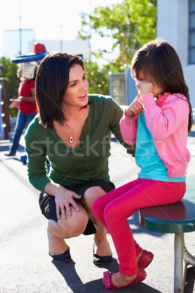 Teacher Comforting Upset Elementary School Pupil Stock photo © monkey_business