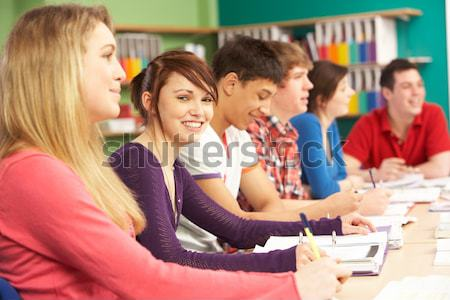 Female Pupil Studying At Desk In Classroom Stock photo © monkey_business