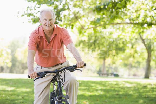Stock photo: Senior man on cycle ride