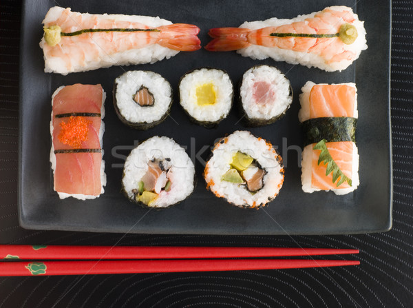 Selection of Seafood And Vegetable Sushi With Chopsticks Stock photo © monkey_business