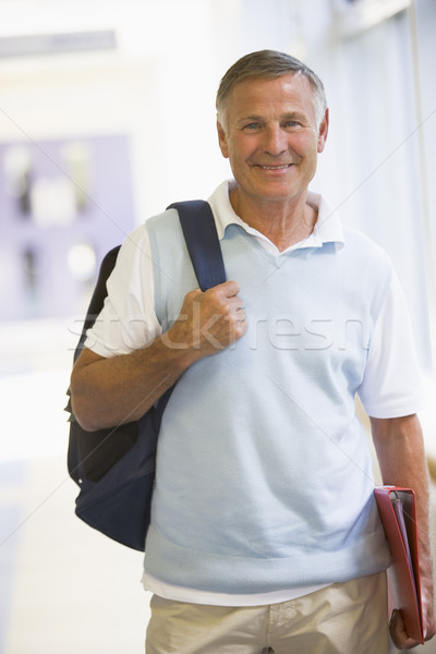A man with a backpack standing in a campus corridor Stock photo © monkey_business