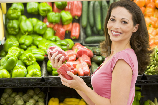 Woman shopping in produce section Stock photo © monkey_business