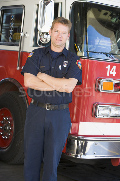 Portrait of a firefighter by a fire engine Stock photo © monkey_business