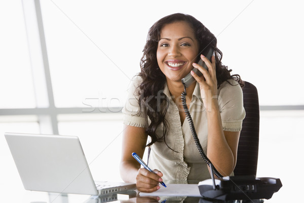 Businesswoman taking telephone call  Stock photo © monkey_business