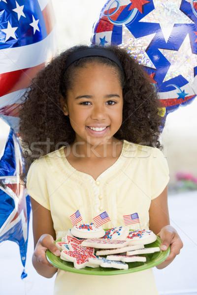 Genç kız dördüncü balonlar kurabiye gülen kız Stok fotoğraf © monkey_business
