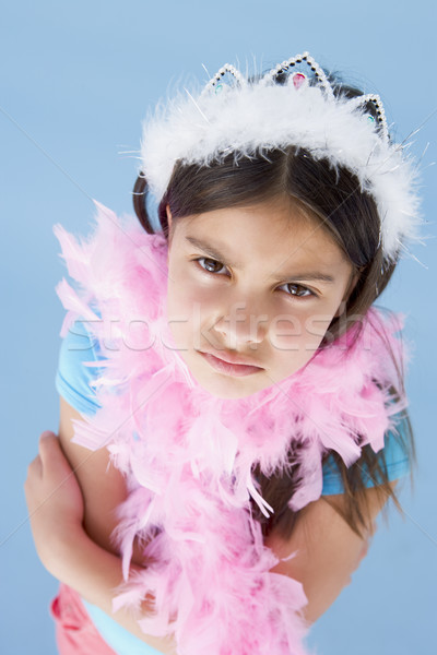 Young girl wearing crown and feather boa frowning Stock photo © monkey_business